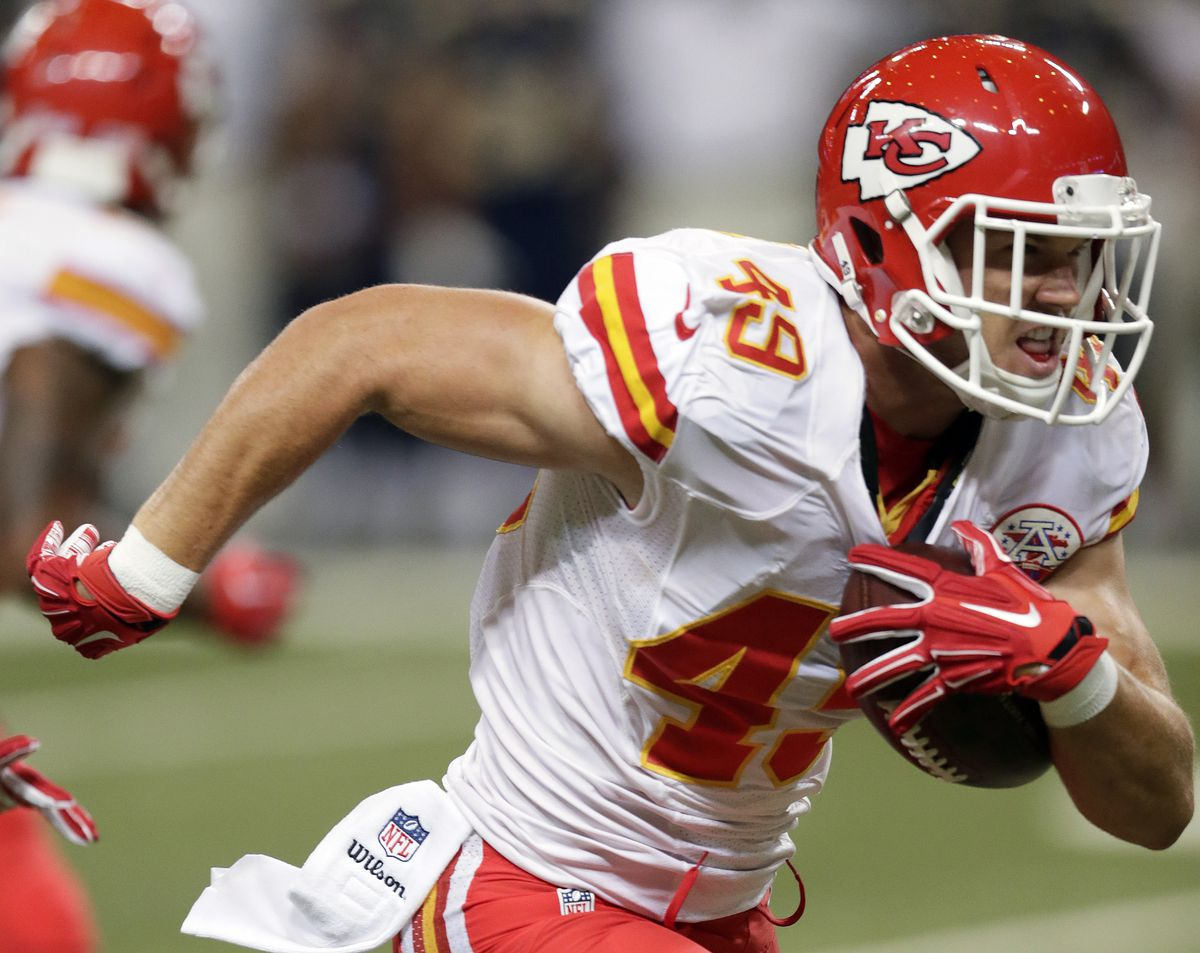 Kansas City Chiefs defensive back Daniel Sorensen runs with the ball after intercepting a pass during the first quarter of an NFL preseason football game against the St. Louis Rams Thursday, Sept. 3, 2015, in St. Louis.