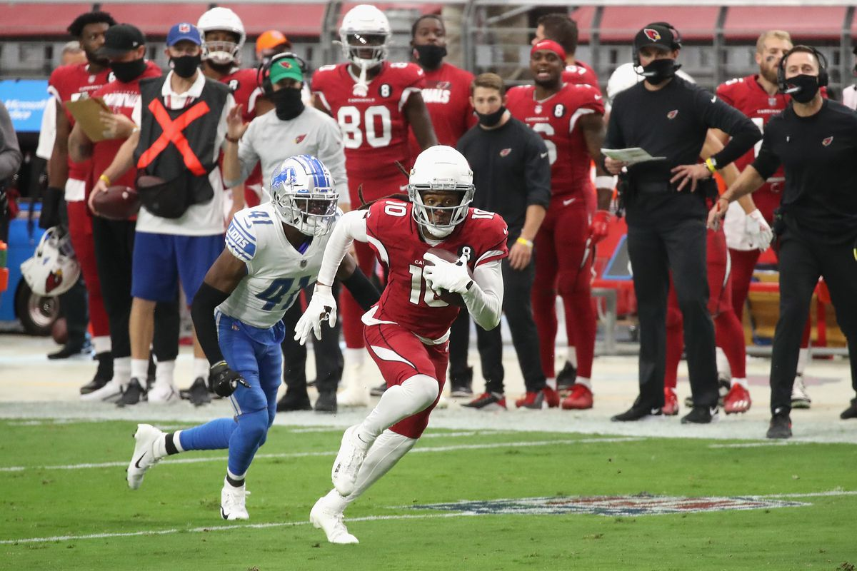 Wide receiver DeAndre Hopkins of the Arizona Cardinals runs with the football past defensive back Chris Jones of the Detroit Lions in the NFL game at State Farm Stadium on September 27, 2020 in Glendale, Arizona.
