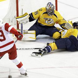 Nashville Predators goalie Pekka Rinne (35), of Finland, and defenseman Shea Weber (6) block the path of a shot by Detroit Red Wings center Pavel Datsyuk (13), of Russia, in the first period of Game 1 of a first-round NHL hockey playoff series on Wednesday, April 11, 2012, in Nashville, Tenn.