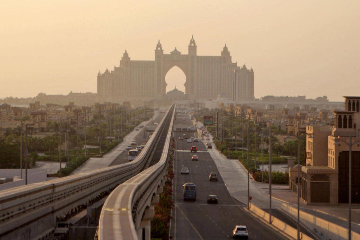 FILE-- This Wednesday Sept. 8, 2010 file photo shows an avenue leading to the Atlantis hotel on Palm Jumeira Island in Dubai, United Arab Emirates. Dubai says it now has full control over the Atlantis resort hotel perched at the top of its palm-shaped isl