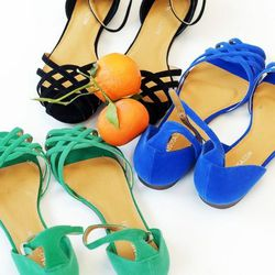 "<a href=""https://www.maraisusa.com/products-page/new-arrivals/seaside-sandal-emerald/"">Velvet Woven Sandals</a>, $100 at MaraisUSA"