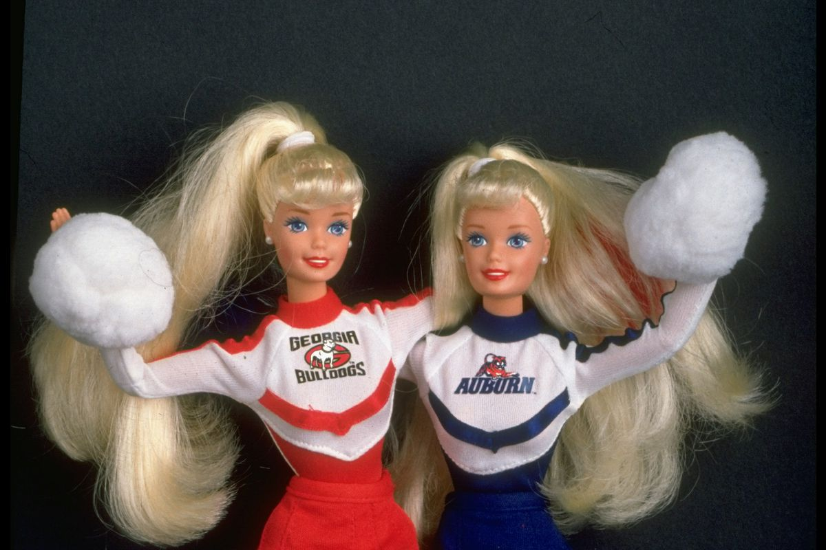 Toys: Portrait of Barbie dolls dressed in Auburn and