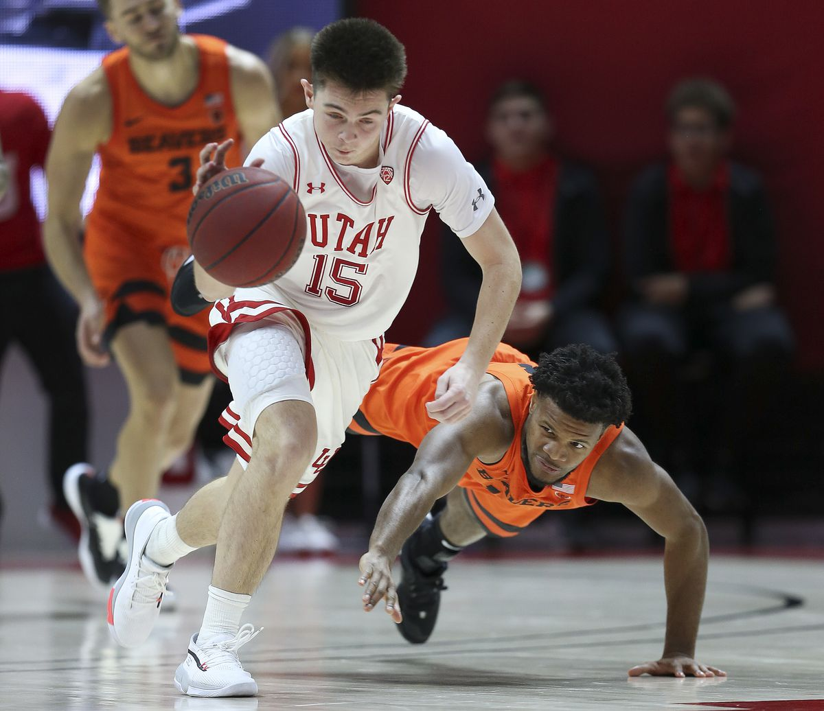 Utah Utes guard Rylan Jones (15) is fouled by Oregon State Beavers guard Antoine Vernon (13) in Salt Lake City on Thursday, Jan. 2, 2020. Utah won 81-69.