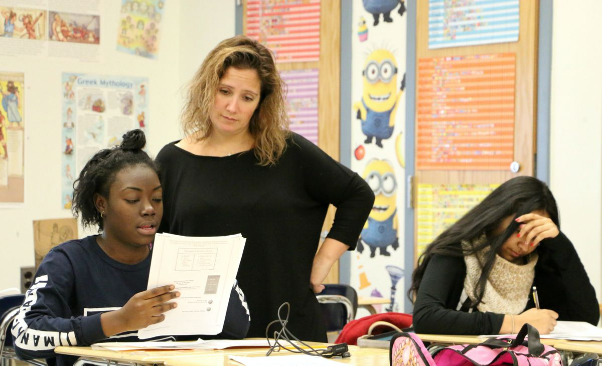 English teacher Gina Malanga works with a student at Richard R. Green High School of Teaching in lower Manhattan.