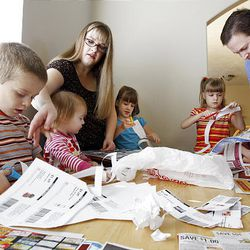 Nathan, left, Juliette, Cassie, Audrey, Katrina and Alex Michael, of Clearfield, practice thriftiness by clipping coupons.