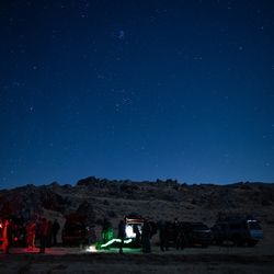 """A group gathers to view the """"Great Conjunction"""" of Saturn and Jupiter in the West Desert on Monday, Dec. 21, 2020. Also dubbed the Christmas Star, the conjunction is the closest together the two planets have passed in Earth's sky in nearly 400 years."""