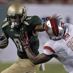 South Florida wide receiver Andre Davis (81) stiff-arms Rutgers defensive back Logan Ryan (11) after a reception during the first quarter of an NCAA college football game Thursday, Sept. 13, 2012, in Tampa, Fla.