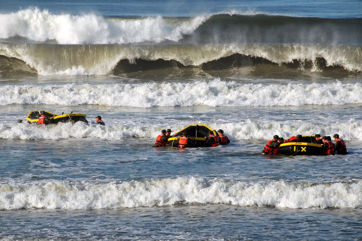 US Navy SEAL recruits participate in a surf passage training exercise