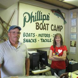 Reed Killpack and Tracy Phillips hold down the fort at Phillips's Boat Camp, a Strawberry institution.