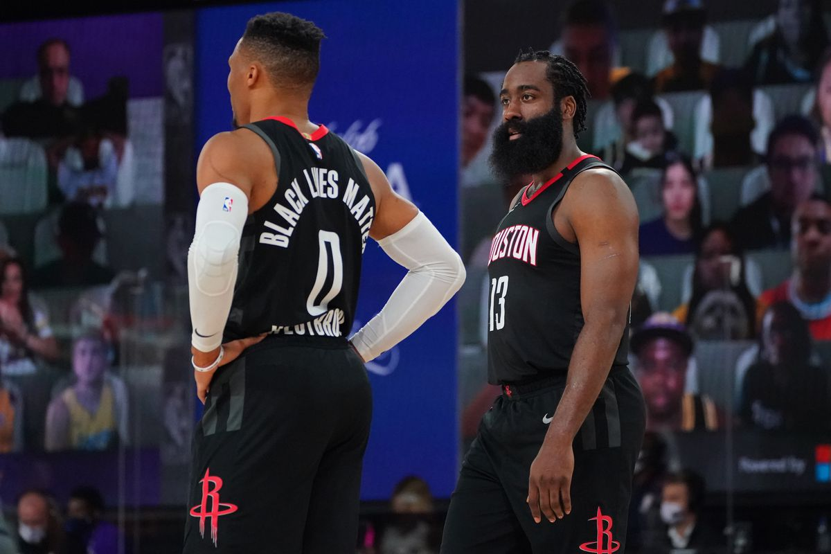 Russell Westbrook #0 and James Harden #13 of the Houston Rockets look on during the game against the Los Angeles Lakers during Game Five of the Western Conference SemiFinals of the NBA Playoffs on September 12, 2020 at AdventHealth Arena in Orlando, Florida.