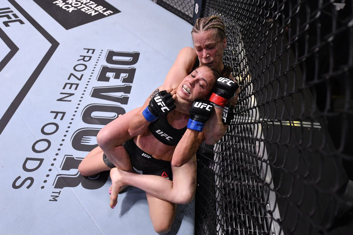 Katlyn Chookagian attempts to secure a rear choke submission against Antonina Shevchenko of Kyrgyzstan in their flyweight fight during the UFC Fight Night event at UFC APEX on May 30, 2020 in Las Vegas, Nevada.