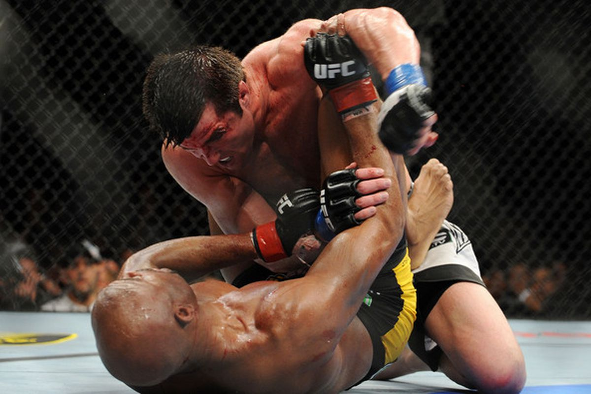 OAKLAND CA - AUGUST 07:  Chael Sonnen punches Anderson Silva while on the ground during the UFC Middleweight Championship bout at Oracle Arena on August 7 2010 in Oakland California.  (Photo by Jon Kopaloff/Zuffa LLC/Zuffa LLC via Getty Images)