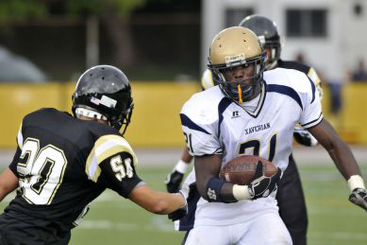 Xavieran junior Mario Tull hauls in a 62-yard toucdown pass against St. Joseph by the Sea. Photo by Damion Reid