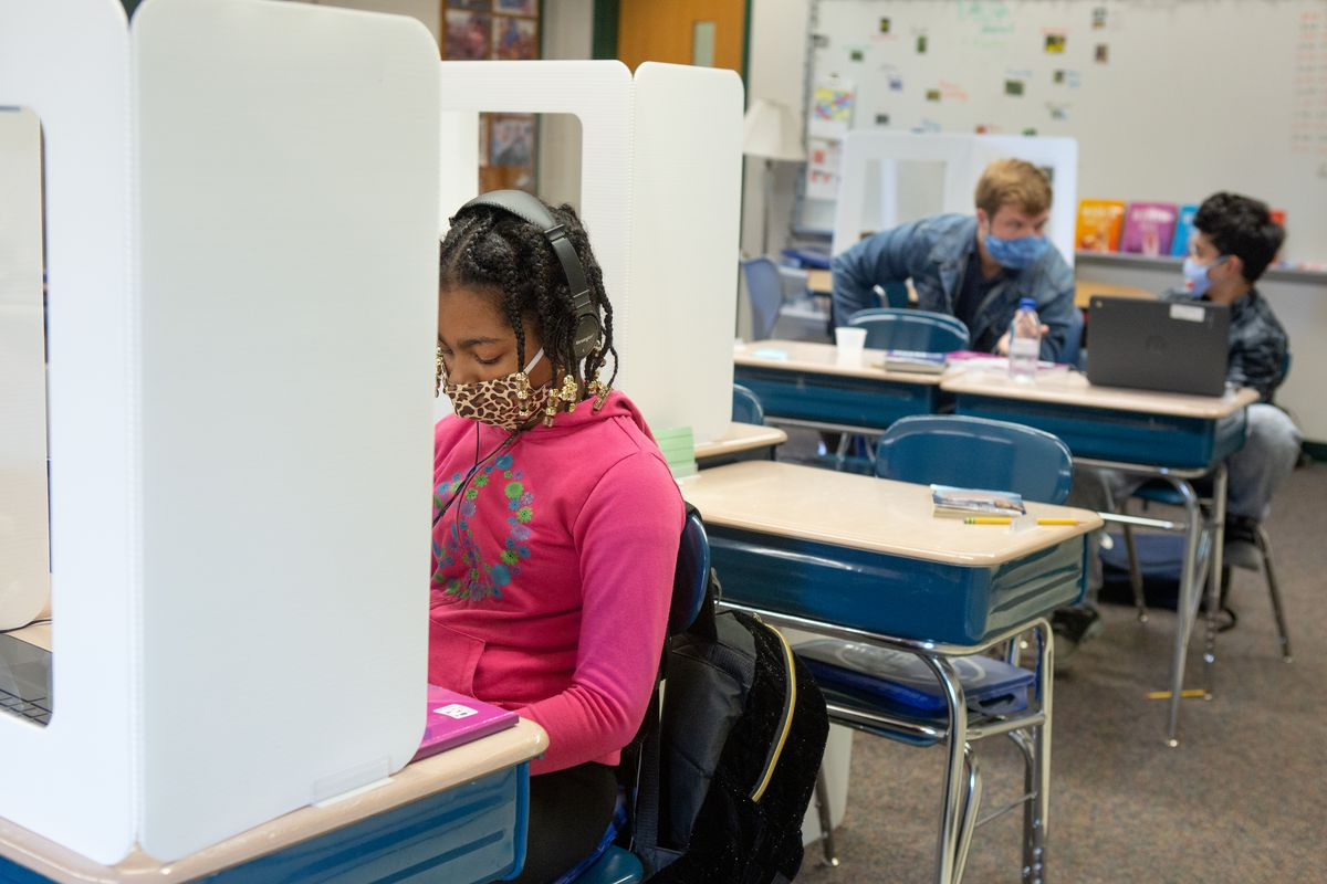The education department says it has a comprehensive strategy to curb the spread of COVID within schools next year. The strategy includes two air purifiers in each classroom along with mandated masking and social distancing.