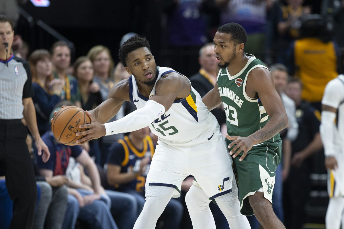 Utah Jazz guard Donovan Mitchell holds the ball while defended by Milwaukee Bucks guard Sterling Brown during the second half at Vivint Smart Home Arena.