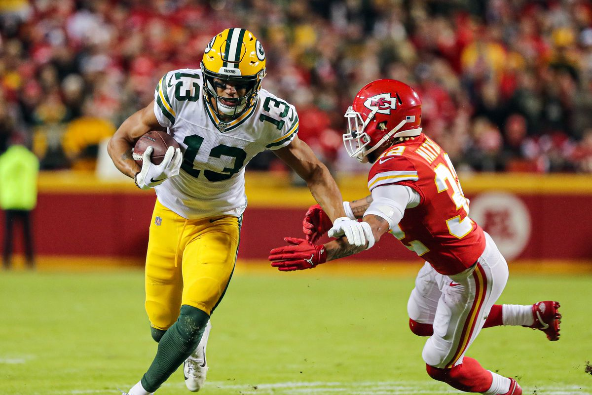 Green Bay Packers wide receiver Allen Lazard runs against Kansas City Chiefs strong safety Tyrann Mathieu during the second half at Arrowhead Stadium.