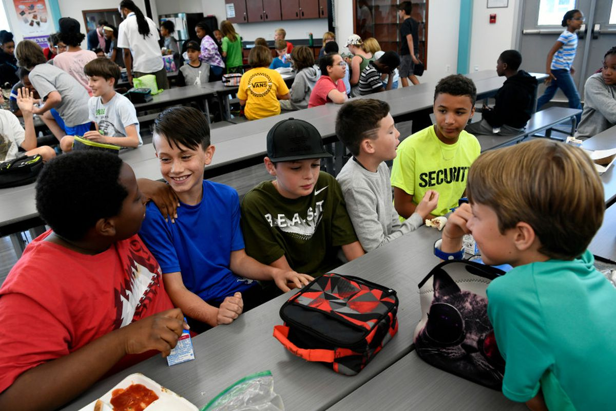Students eat lunch at Denver Green School Northfield. The schools is in an enrollment zone.