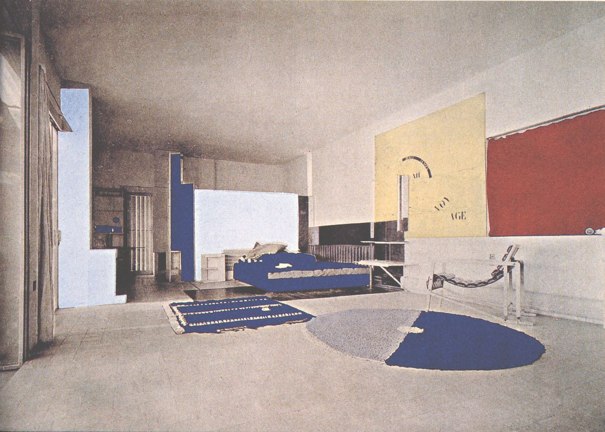 Diagrammed photo of interior with a bed, chair, and colored panels on walls.