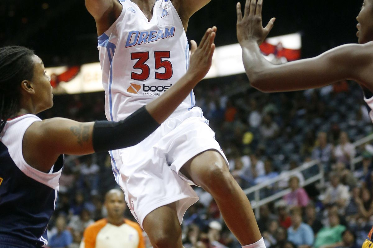 Sep 2, 2012; Atlanta, GA, USA; Atlanta Dream guard Angel McCoughtry (35) goes up for a shot over two Connecticut Sun defenders during the fourth quarter at Philips Arena. The Dream defeated the Sun 87-80. Mandatory Credit: Josh D. Weiss-US PRESSWIRE