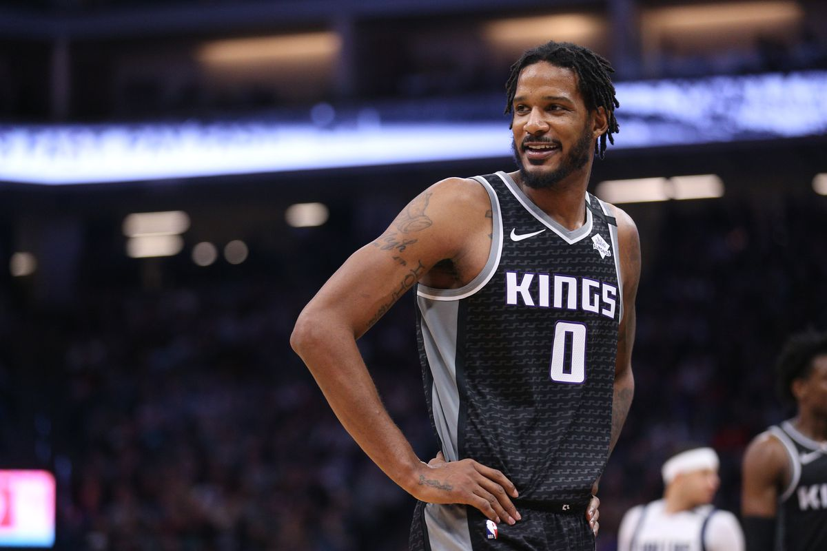 Sacramento Kings forward Trevor Ariza interacts with players from the Dallas Mavericks during a break in the action in the third quarter at the Golden 1 Center.