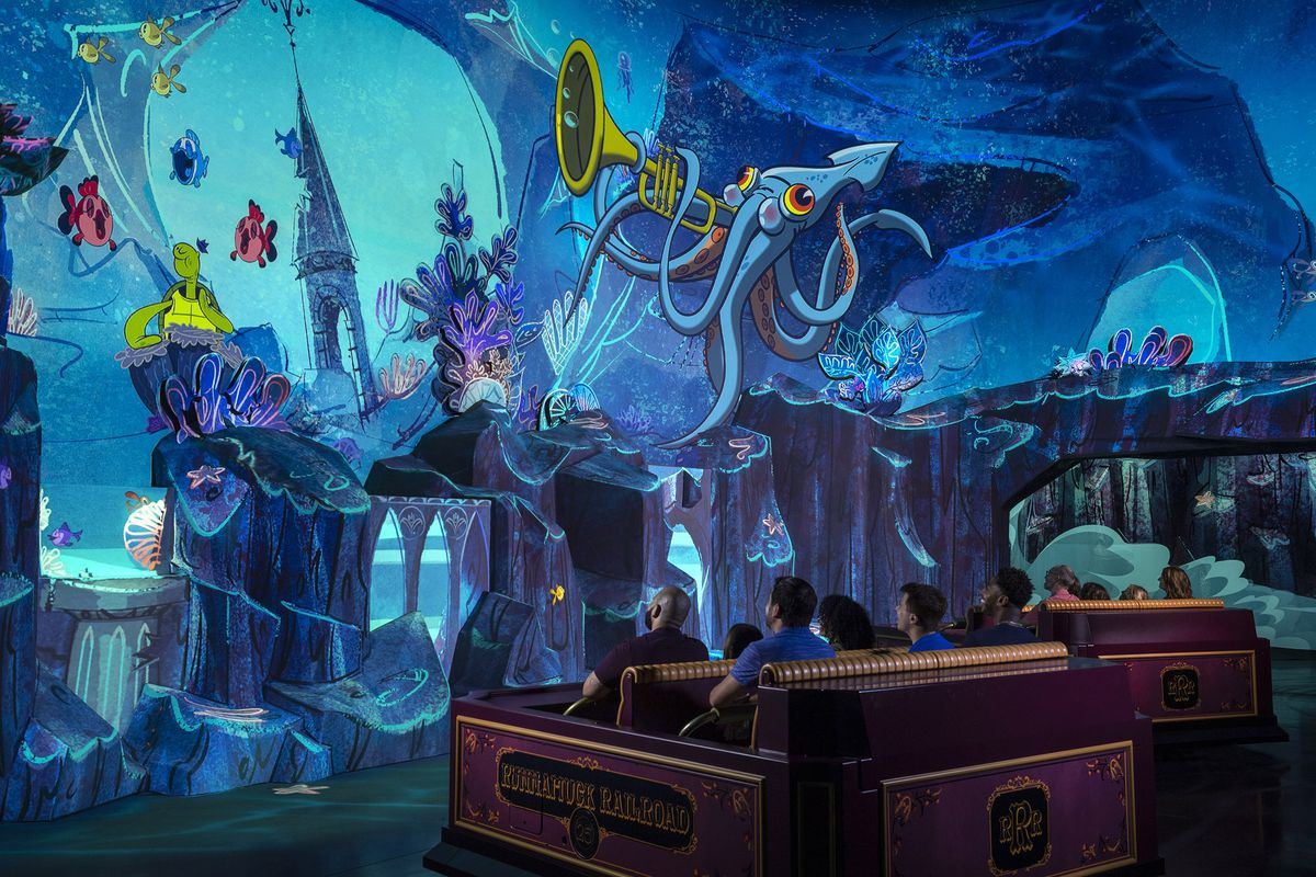 """Guests travel underwater as part of their journey through the vibrant world of """"Mickey Mouse"""" cartoon shorts in Mickey & Minnie's Runaway Railway."""