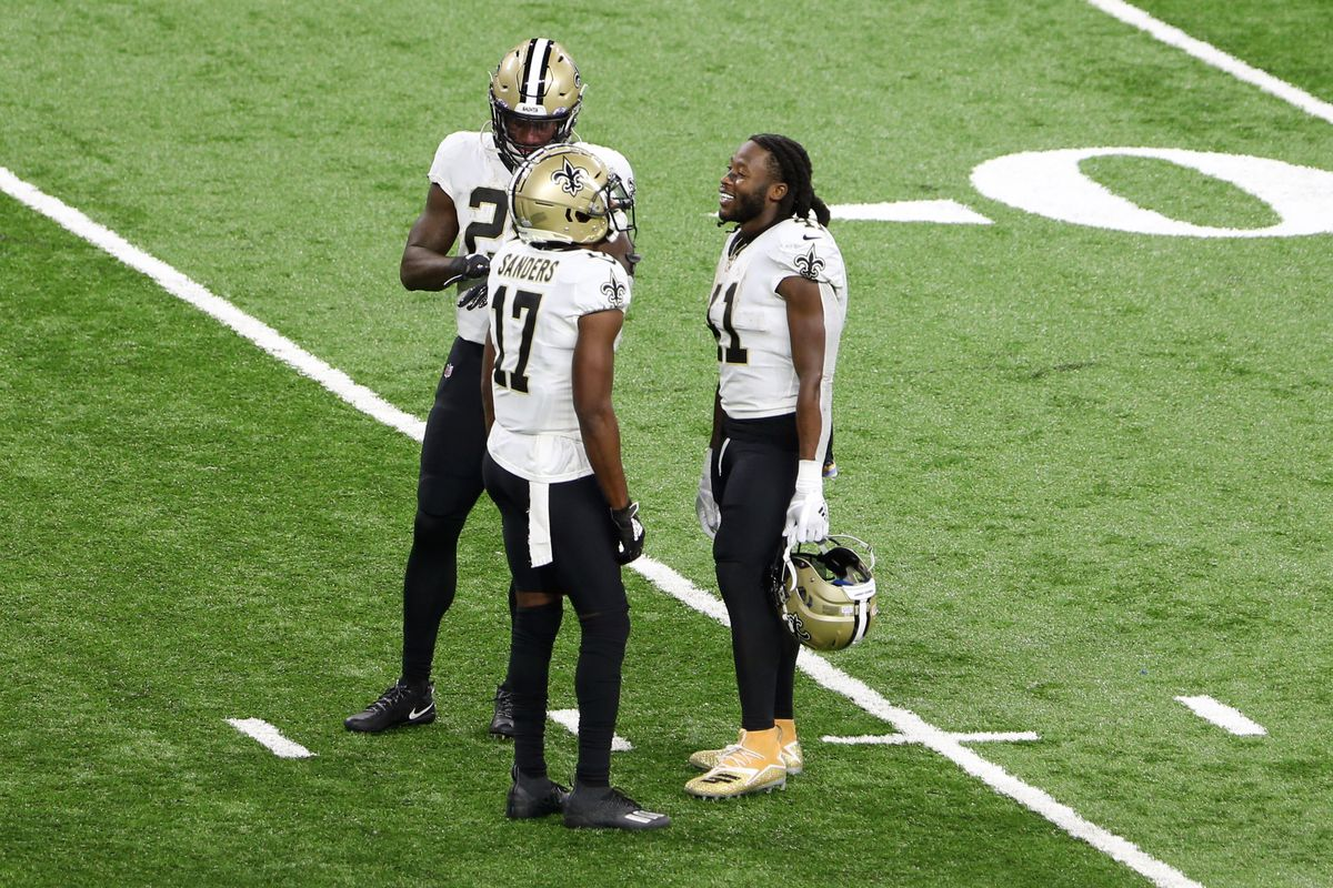 New Orleans Saints running back Alvin Kamara (41) talks with New Orleans Saints wide receiver Emmanuel Sanders (17) and New Orleans Saints running back Latavius Murray (28) between plays during the first half of an NFL football game against the Detroit Lions in Detroit, Michigan USA, on Sunday, October 4, 2020.