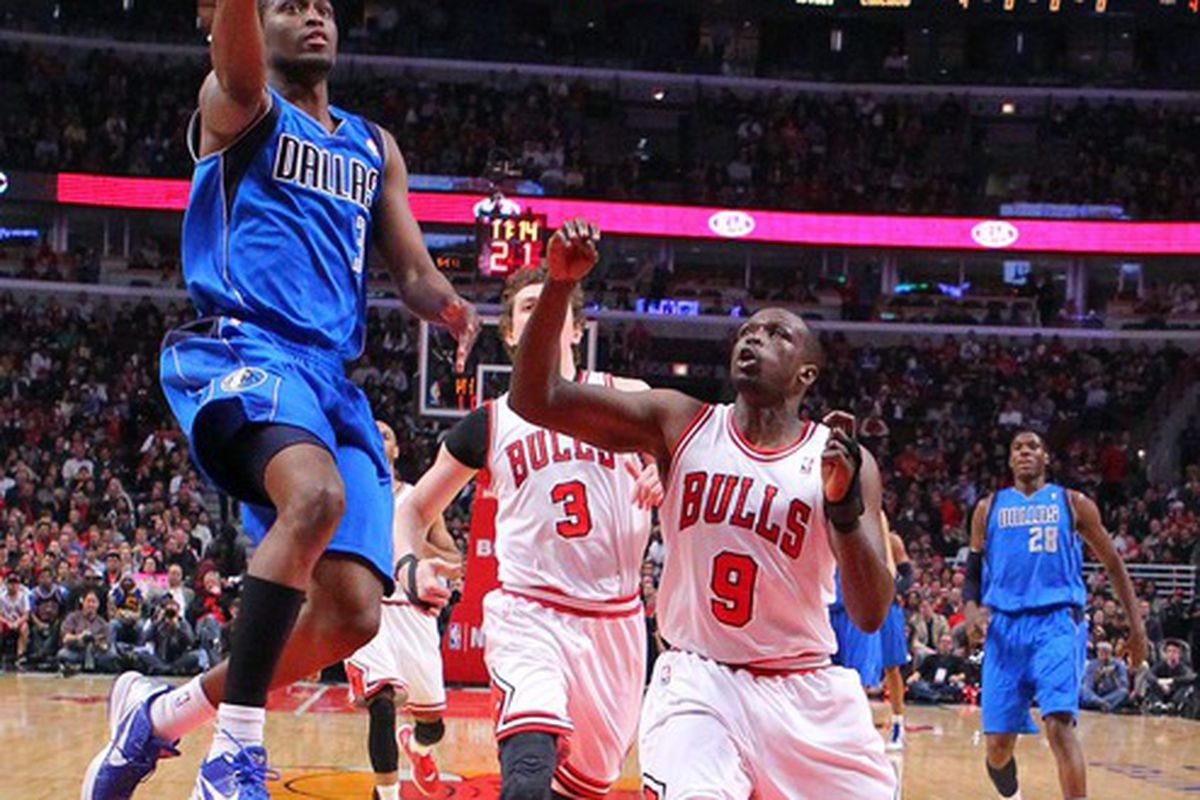Apr 21, 2012; Chicago, IL, USA; Dallas Mavericks guard Rodrigue Beaubois (3) scores past Chicago Bulls small forward Luol Deng (9) during the first half at the United Center. Mandatory Credit: Dennis Wierzbicki-US PRESSWIRE