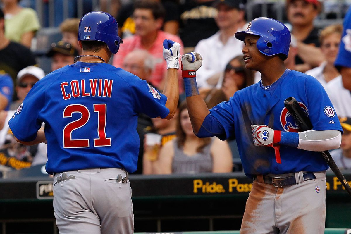 Tyler Colvin of the Chicago Cubs is congratulated by teammate Starlin Castro after scoring against the Pittsburgh Pirates during the game on August 2, 2011 at PNC Park in Pittsburgh, Pennsylvania. (Photo by Jared Wickerham/Getty Images)