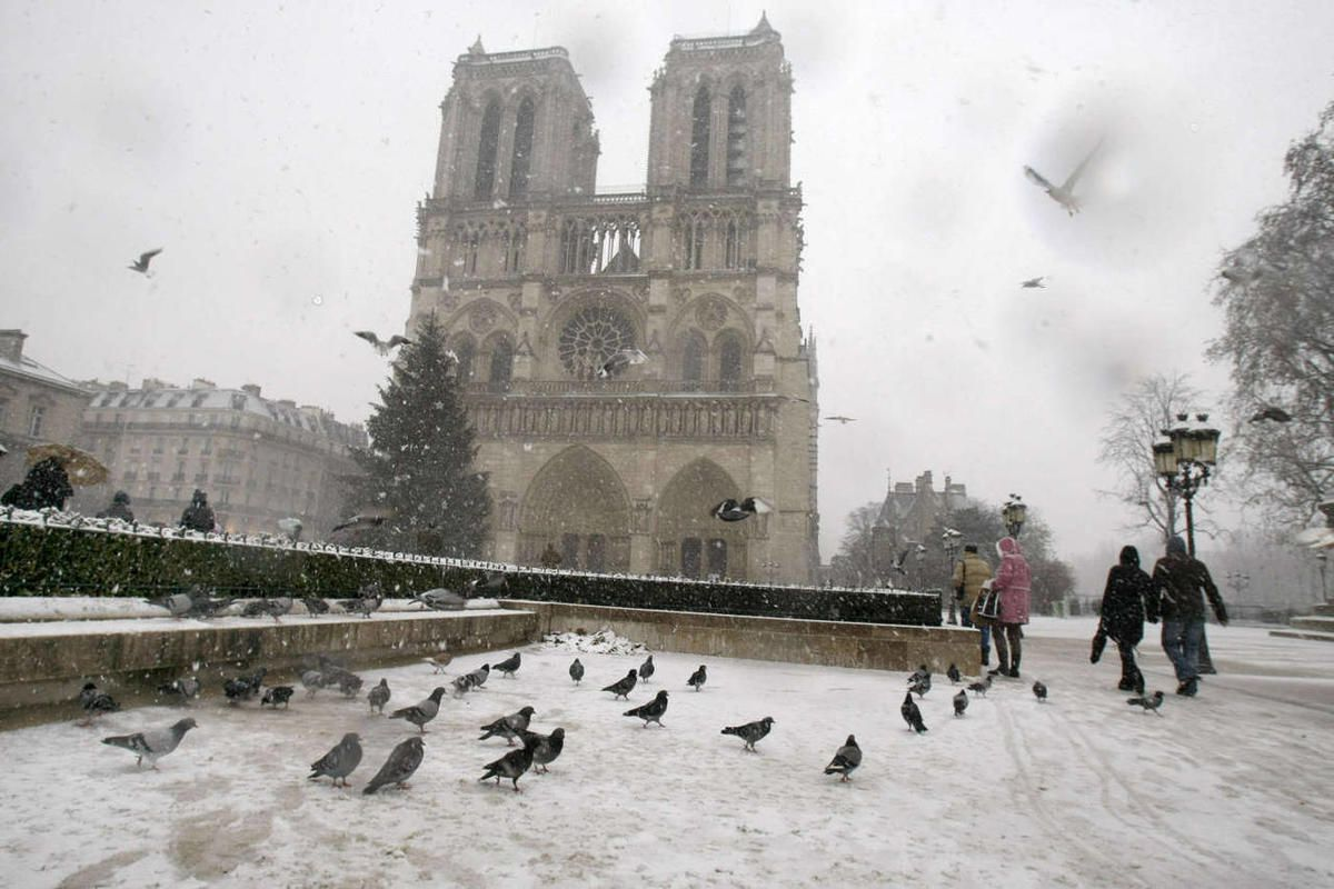 Notre Dame cathedral is seen under the snow in Paris, Wednesday Dec. 8, 2010.