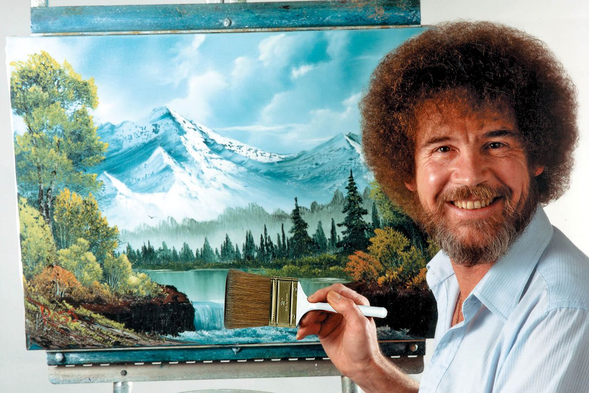 Artist Bob Ross at a canvas holding a paint brush.