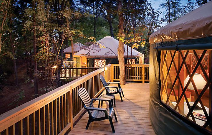 Two yurts in Virginia. There is a wooden deck attached to each yurt.