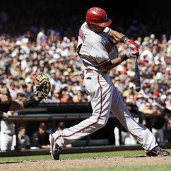 Arizona Diamondbacks' Chris Young drives in a run with a single against the San Francisco Giants during the sixth inning of a baseball game, Monday, Sept. 3, 2012, in San Francisco.