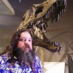 Dr. Mark Loewen stands by a Lythronax skeleton. The new species of dinosaur dubbed the King of Gore was discovered at the Grand Staircase-Escalante National Monument in Utah and was announced Wednesday at the Natural History Museum of Utah. The species is related to the Tyrannosaurus rex.