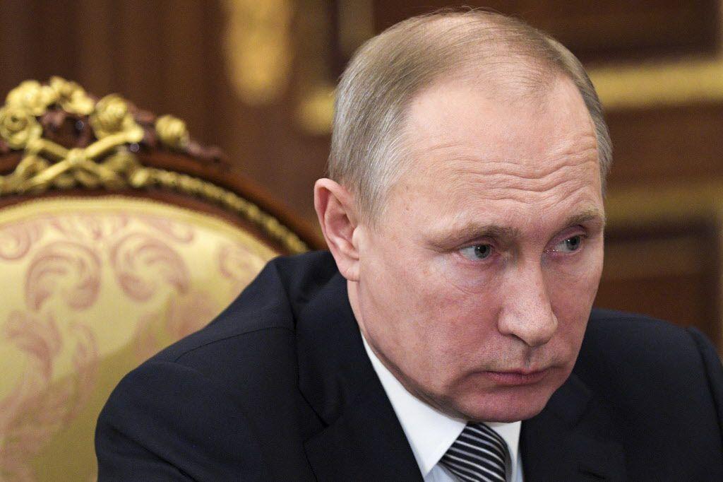 Russian President Vladimir Putin listens during a meeting in the Kremlin in Moscow, Russia, on Friday, Feb. 3, 2017. | Alexei Druzhinin/Sputnik, Kremlin Pool Photo via AP