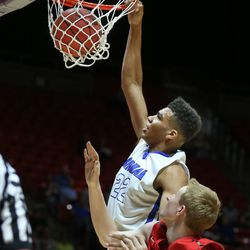 Bingham's Yoeli Childs dunks as Bingham High School defeats American Fork High School in the 5A State Boys Basketball State Tournament quarterfinals Thursday, March 3, 2016, in Salt Lake City.