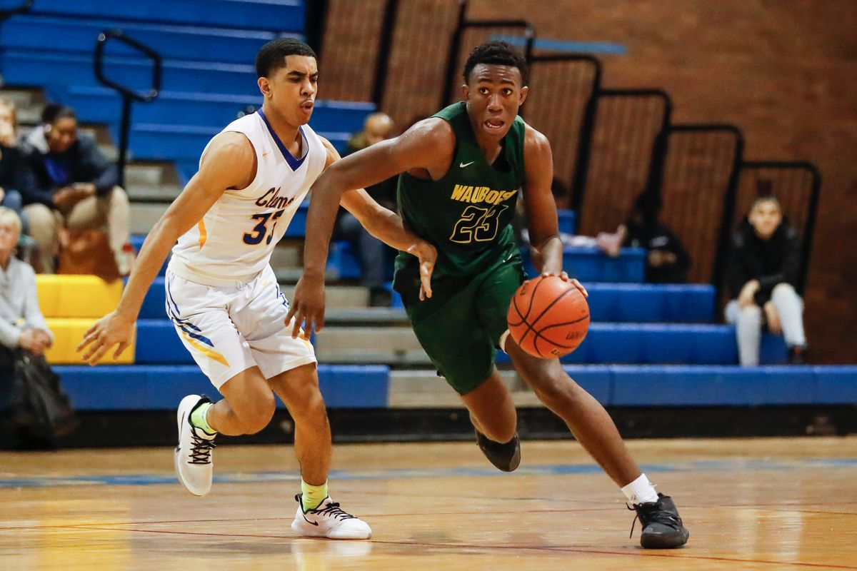 Waubonsie Valley's Marcus Skeete (23) takes the ball past Clemente's Terrell Taylor (33).