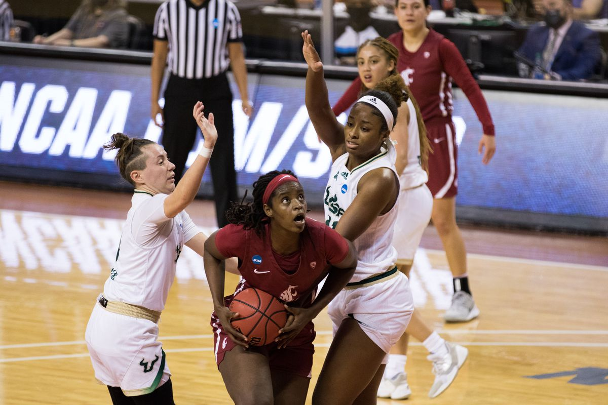 AUSTIN, TX - MARCH 21: Washington State center Bella Murekatete (55) gets pressured under the hoop during the third quarter of the Women's NCAA Tournament First Round matchup between the USF Bulls and the Washington State Cougars on March 21, 2021, at Frank Erwin Center in Austin, TX.