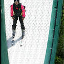 Katie Sciuto, Anchorage, prepares to jump at Air School. Students fly high enough to try ski-jumping tricks.