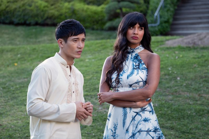 Tahani and Jason view someone skeptically.