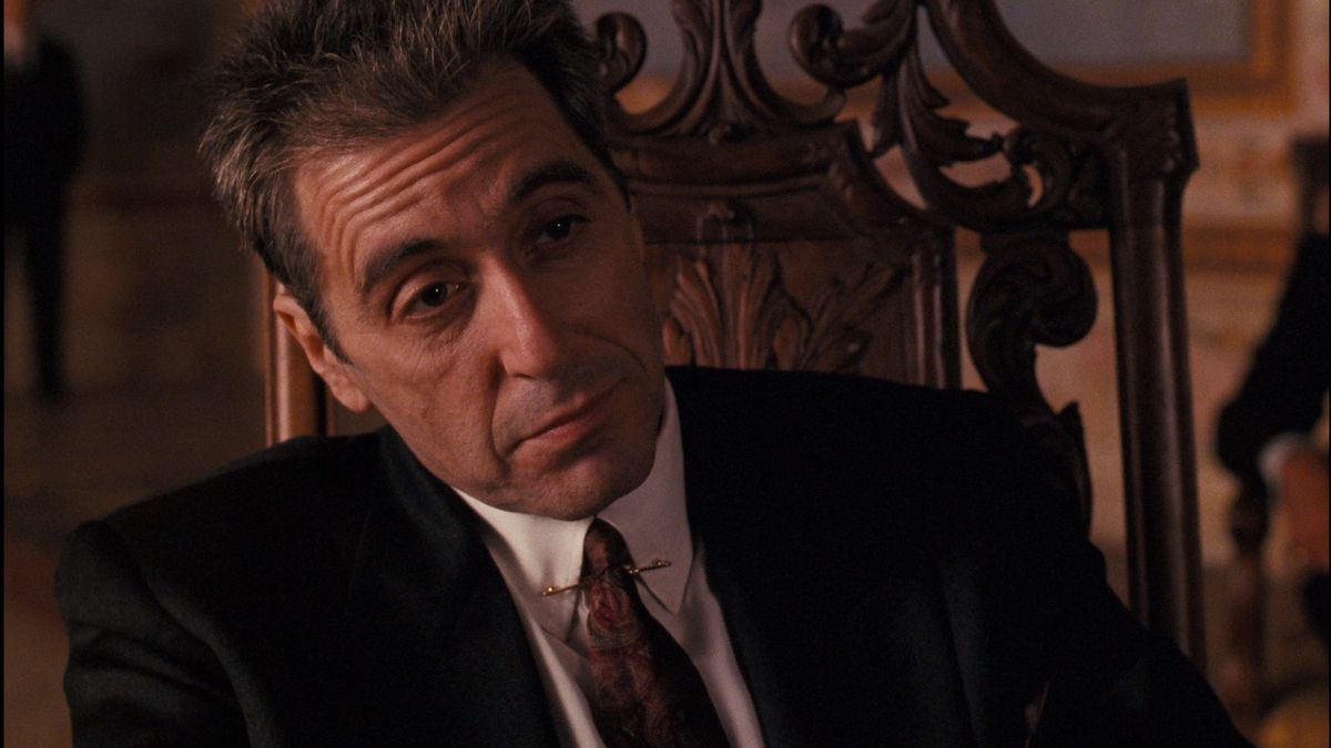 al pacino sits back as Michael Corleone in the godfather part 3