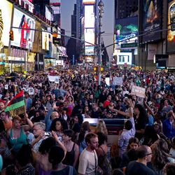 Throngs of marches arrive on Times Square, Sunday, July 14, 2013, in New York, for a protest against the acquittal of volunteer neighborhood watch member George Zimmerman in the 2012 killing of 17-year-old Trayvon Martin in Sanford, Fla. Demonstrators upset with the verdict protested mostly peacefully in Florida, Milwaukee, Washington, Atlanta and other cities overnight and into the early morning. (AP Photo/Craig Ruttle)