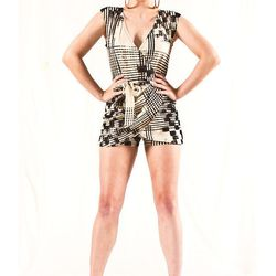 """A romper or jumpsuit is an easy outfit. Pair with flat sandals for day, and add funky jewelry and wedges for a sexy summer nighttime look. <a href=""""https://lobo-mau.myshopify.com/products/printed-wrap-skort-romper"""">Printed Wrap Skort Romper</a>, $175 from"""