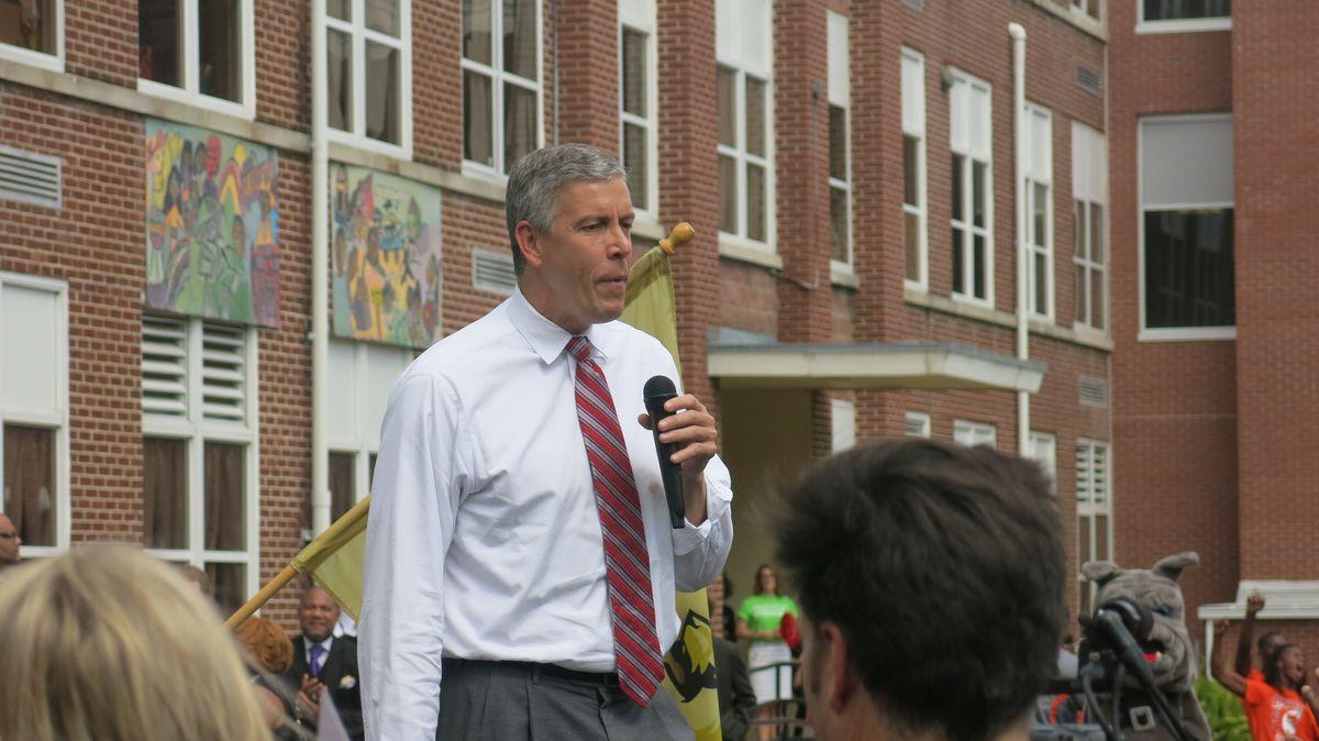 Education Secretary Arne Duncan addresses the crowd outside Cornerstone, formerly Lester Elementary, in Binghamton.
