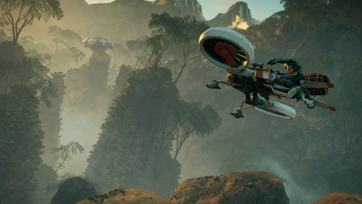The player flies in an Icarus drone-copter over a lush biome in a screenshot from Rage 2.