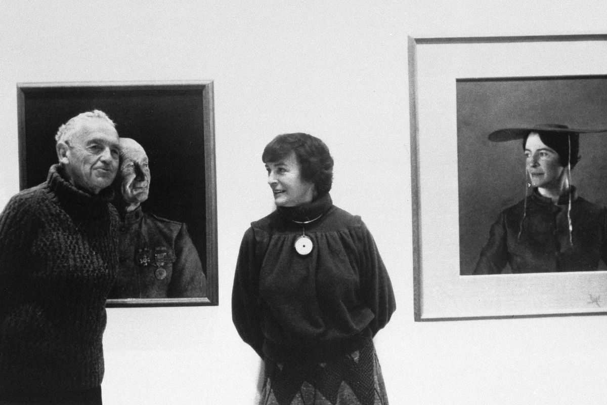 """American artist Andrew Wyeth poses with his wife Betsy in 1985 in front of his paintings """"The Patriot"""" (left) and """"Maga's Daughter"""" for which Betsy was the model."""