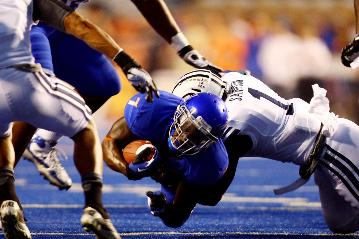 Sep 20, 2012; Boise, ID, USA; Boise State Broncos running back D.J. Harper (7) dives for a first down during first half action against the BYU Cougars at Bronco Stadium.   Mandatory Credit: Brian Losness-US PRESSWIRE
