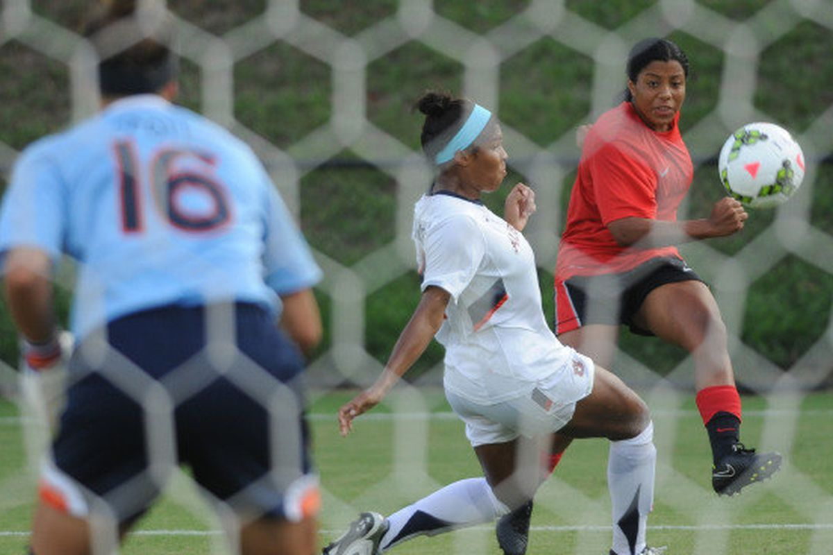 Junior Bria Washington, listed as a forward/defender (wtf?) appears to fire a shot at Auburn's goal.