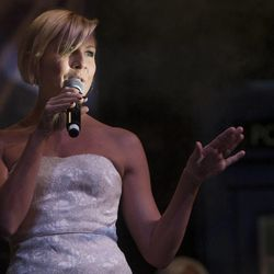 Gigi Edgley arrives on stage during the Salt Lake Comic Con kickoff news conference at the Salt Palace Convention Center in Salt Lake City, Thursday, Sept. 4, 2014.