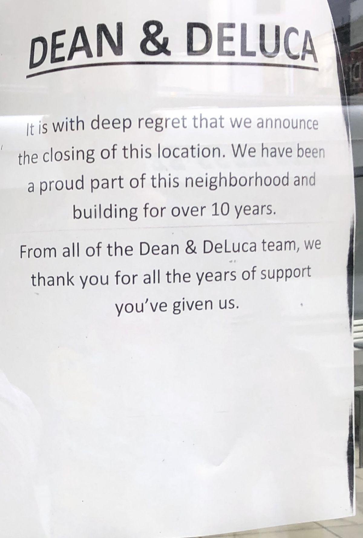 A sign announcing Dean & DeLuca's closure