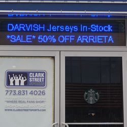 Sale displayed at Clark Street Sports, across from the ballpark